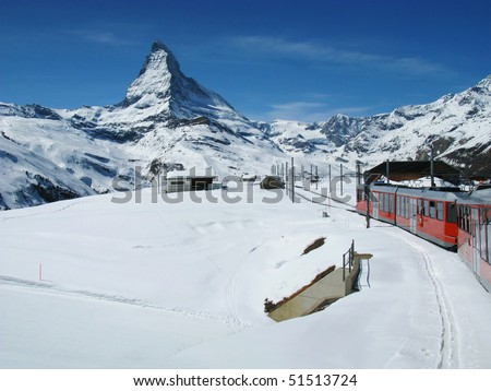 The train, at the Swiss Alps with the Matterhorn in the background - stock photo