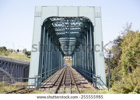 The train bridge over Saint John River in St. John town (New Brunswick, Canada). - stock photo