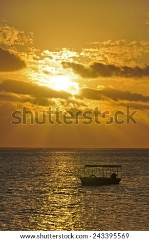The tranquil beaches of the  South Pacific Ocean really are paradise found. This sunset is over the Coral Coast on the island of Viti Levu (Fiji) - stock photo