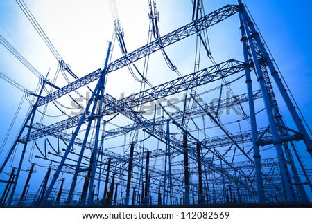 The transmission tower on blue sky background - stock photo