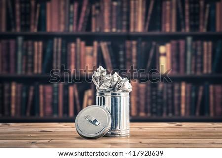 the trash.bookshelf background - stock photo