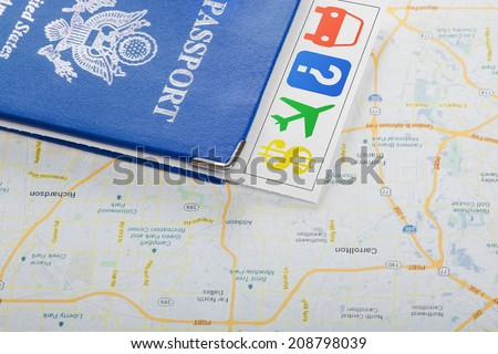 The travel concept. Passport, guide, tickets on map. Closeup. - stock photo