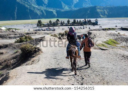 The traveler and Hindo Temple near Mt. Bromo, East Java, Indonesia - stock photo