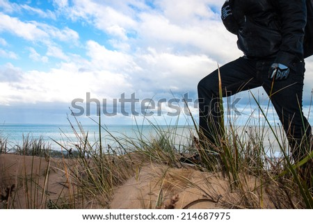 The traveler looks at the view - stock photo