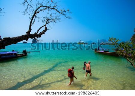 the traveler walking in the sea beach - stock photo