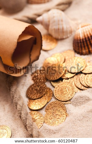 the treasure map and golden coins - stock photo