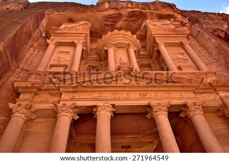 THE TREASURY (El Khasneh).  Petra's temples, tombs, theaters and other buildings are scattered over 400 square miles. UNESCO world heritage site and one of The New 7 Wonders of the World. - stock photo