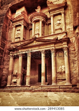 THE TREASURY (El Khasneh). UNESCO world heritage site. Filtered image, vintage effect applied. Grunge and tonal contrast added - stock photo