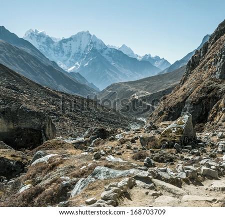 The trek to south alone Gokyo glacier - Nepal, Himalayas - stock photo