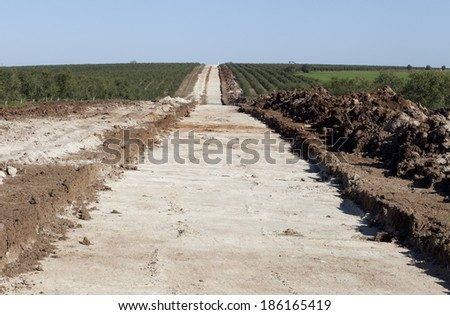 The trench for laying water pipes in the field in Alentejo from Alqueva, Portugal - stock photo