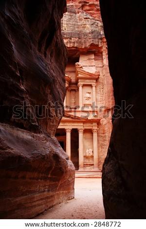 The Tresury from a narrow opening in the Siq, Petra, Jordan - stock photo