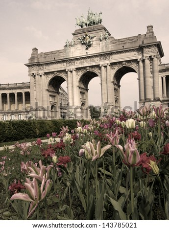 The Triumphal Arch (Arc de Triomphe) in the Cinquantenaire park in Brussels. Built in 1880 for the 50th anniversary of Belgium (sepia image). - stock photo