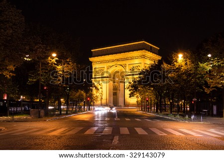 The Triumphal Arch at night, Paris, France. - stock photo