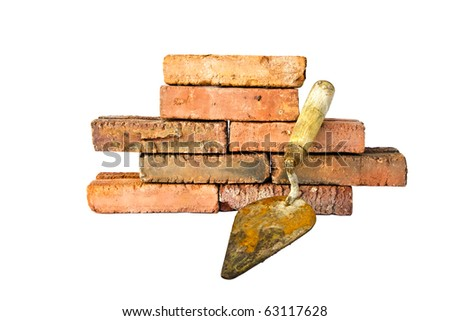 the trowel and old brick on white background - stock photo