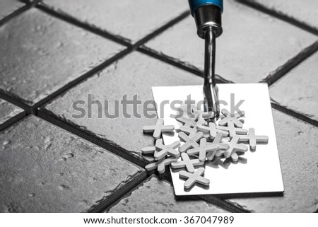the trowel closeup on a background of ceramic tile - stock photo