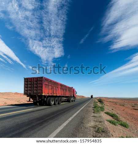 The truck driving on the highway - stock photo