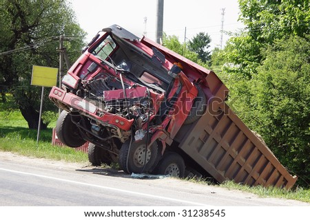 The truck  lies in a ditch after the road accident - stock photo