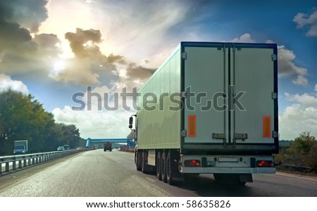 The truck on asphalt road - stock photo