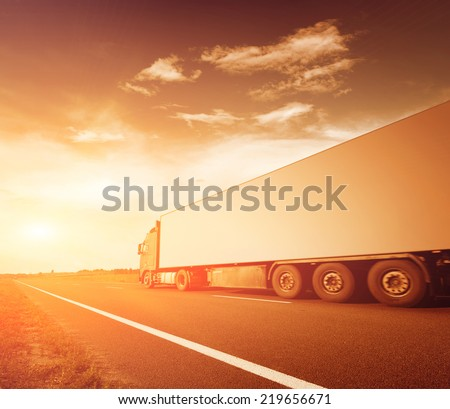 The truck on asphalt road motion blur - stock photo