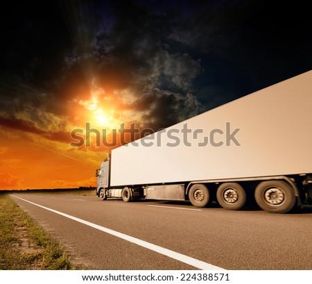 The truck on asphalt road motion blur - stock photo