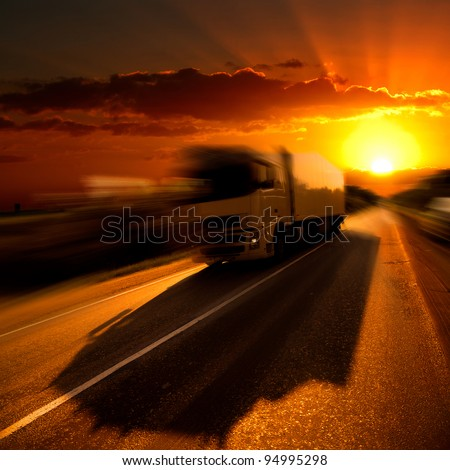 The truck on highway. A sunset. - stock photo