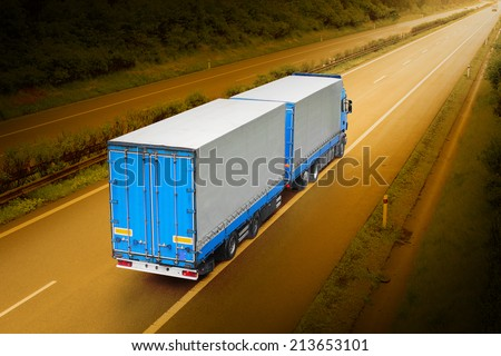 The truck on the highway. Picture with space for your text. - stock photo