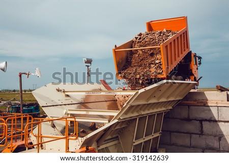 The Truck Unloads Rubble - stock photo