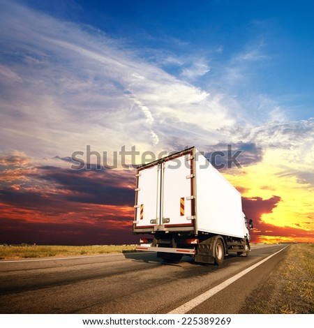 The truck with freight moving fast - stock photo