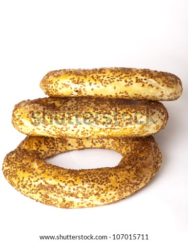 The Turkish bagel strewed by sesame seeds on white background - stock photo
