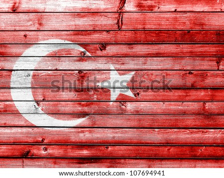 The Turkish flag painted on wooden fence - stock photo