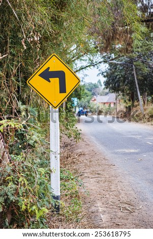 The turn left sign post found in rural street - stock photo