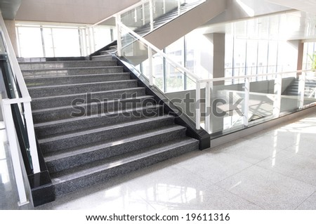 The turning  upward staircase with glass and steel board  in a modern building.