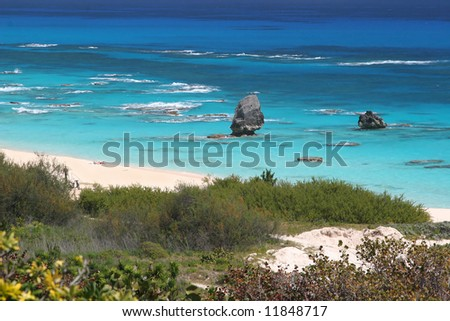 The turquoise ocean and pink beaches of Bermuda. - stock photo
