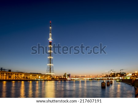 The TV Tower of the Leningrad Radiotelevision transmission Center and the Kantemirovsky bridge in St. Petersburg, with night illumination August 30, 2014 - stock photo