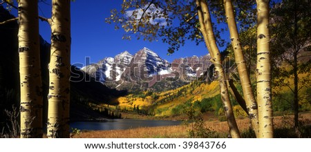 The twin mountains known as the Maroon Bells in Colorado's White River National Forest, near Aspen. - stock photo