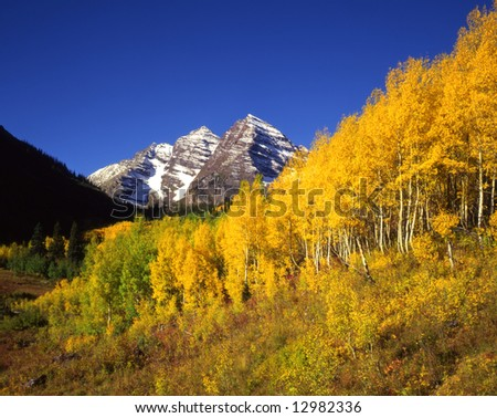 The twin peaks known as the Maroon Bells located in the White River National Forest. - stock photo