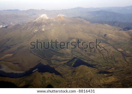 The twin peaks of the Ilinizas Ecuador viewed from the air - stock photo