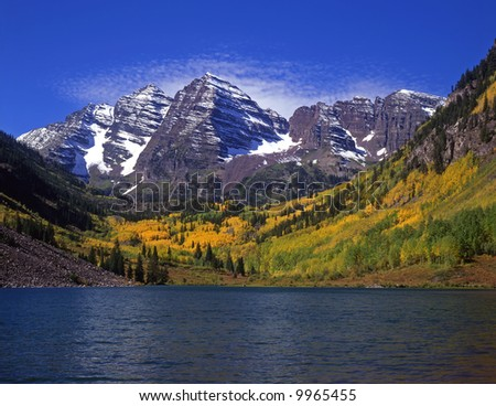 The twin peaks of the Maroon Bells and Maroon Lake in the White River National Forest of Colorado. - stock photo