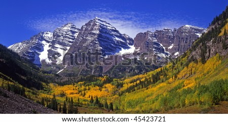 The twin peaks of the Maroon Bells and Maroon Lake, located in the White River National Forest of Colorado, photographed during the autumn season. - stock photo