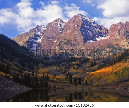 The twin peaks of the Maroon Bells in the White River National Forest, Colorado. - stock photo