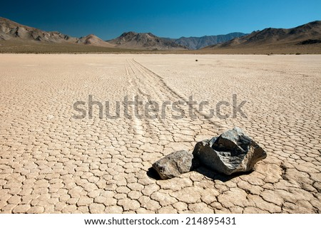 "The ""twins"" at Racetrack Playa at Death Valley - close-up shot of the moving rocks - stock photo"