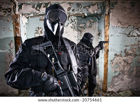 The two armed soldiers in a camouflage costs in alertness - stock photo