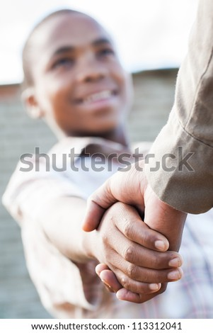 The two brothers agreed to split their salary in half. - stock photo
