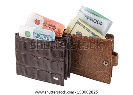 The two brown  leather wallet with euro, dollars and rubles is photographed on the close-up - stock photo