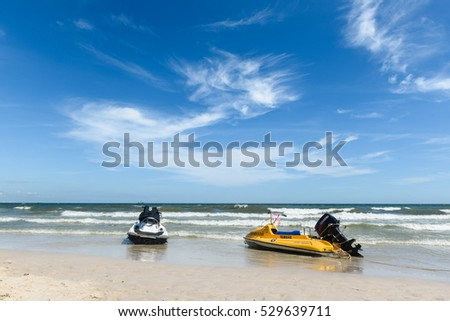 "The two jet skis anchor on the beach at ""HUA HIN"" beach Thailand 27 November 2016,summer,sea background"
