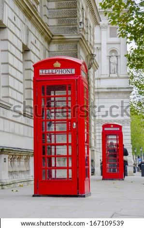 The two red phone boxes at Westminister square in London, UK - stock photo