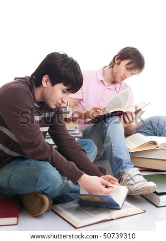 The two students with the books isolated on a white background - stock photo