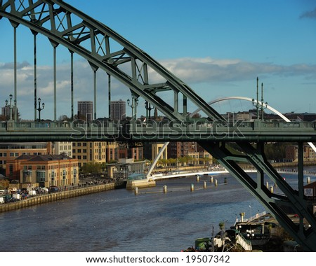 The Tyne Bridge over the River Tyne with the Millennium Bridge in the distance. - stock photo