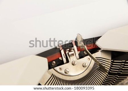 The typewriter with an empty clean sheet of paper - stock photo