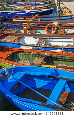 "The typical old boats at the lake ""Gardasee"" in Italy"